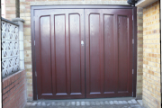 dark red side hinged wooden garage door