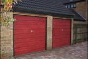 two red garage doors before conversion