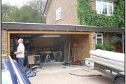 process of fitting wooden garage door