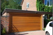wooden garage door and house