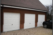 three white garage door with car