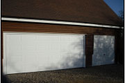 wide two car garage with white door